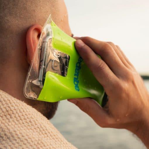 man holding phone in aquapac case