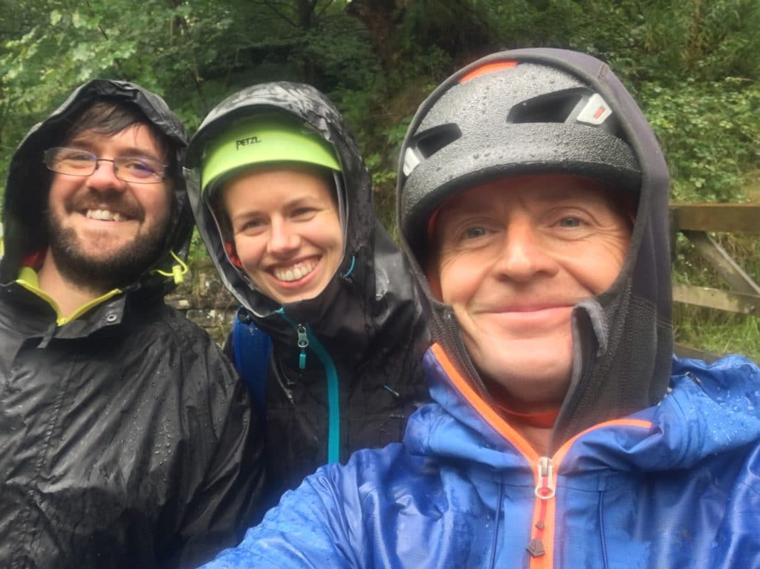 Paul with clients in rain